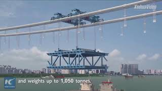 Mega project! Main sections of world's longest double-deck suspension bridge connected in C China