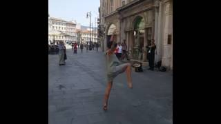 Shy girl performs a stunning ballet dance to the sound of a street violinist in Italy HD 720p 30fps