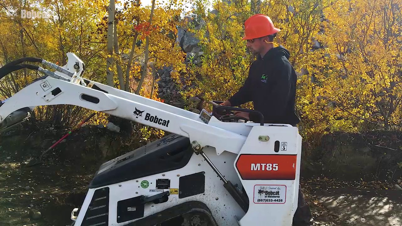 Landscaping crew swaps shovels and wheelbarrows for an MT85