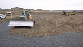 Deere Equipment Using Trimble GPS To Place Gravel Over Geotextile