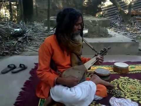 indian famous folk singer TINKARI CHAKOROBARTI IN his mood