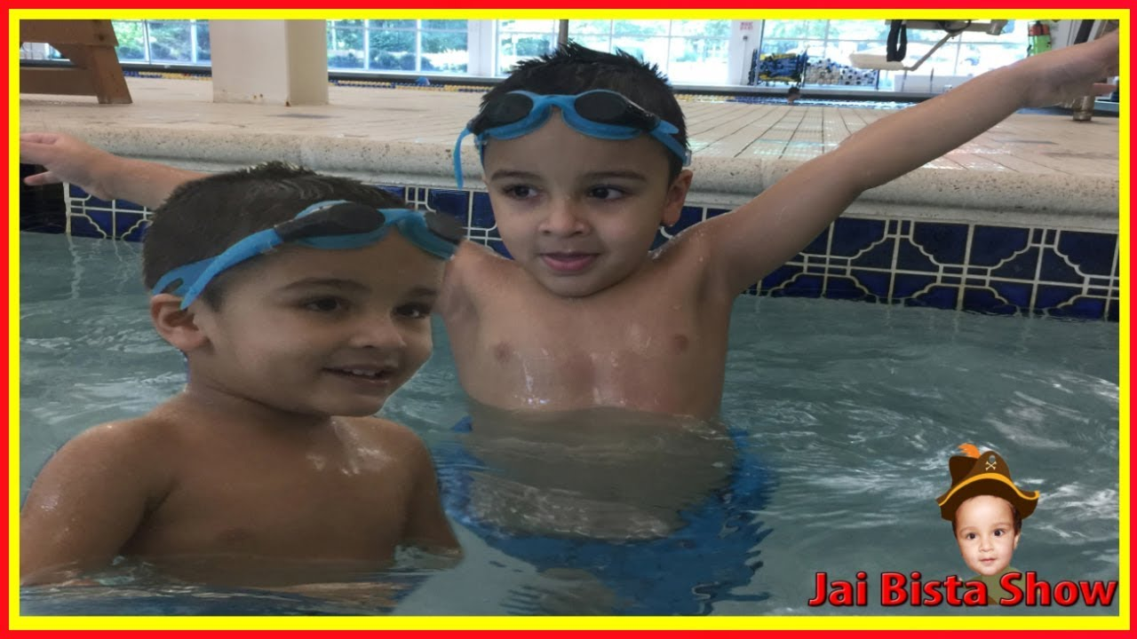 Kids swim in the swimming pool fun indoor pool for kids for Pack swimming