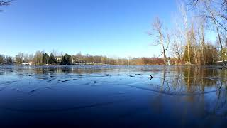 Skipping rocks on the thin ice. The most amazing sound effect ever! Pure Michigan