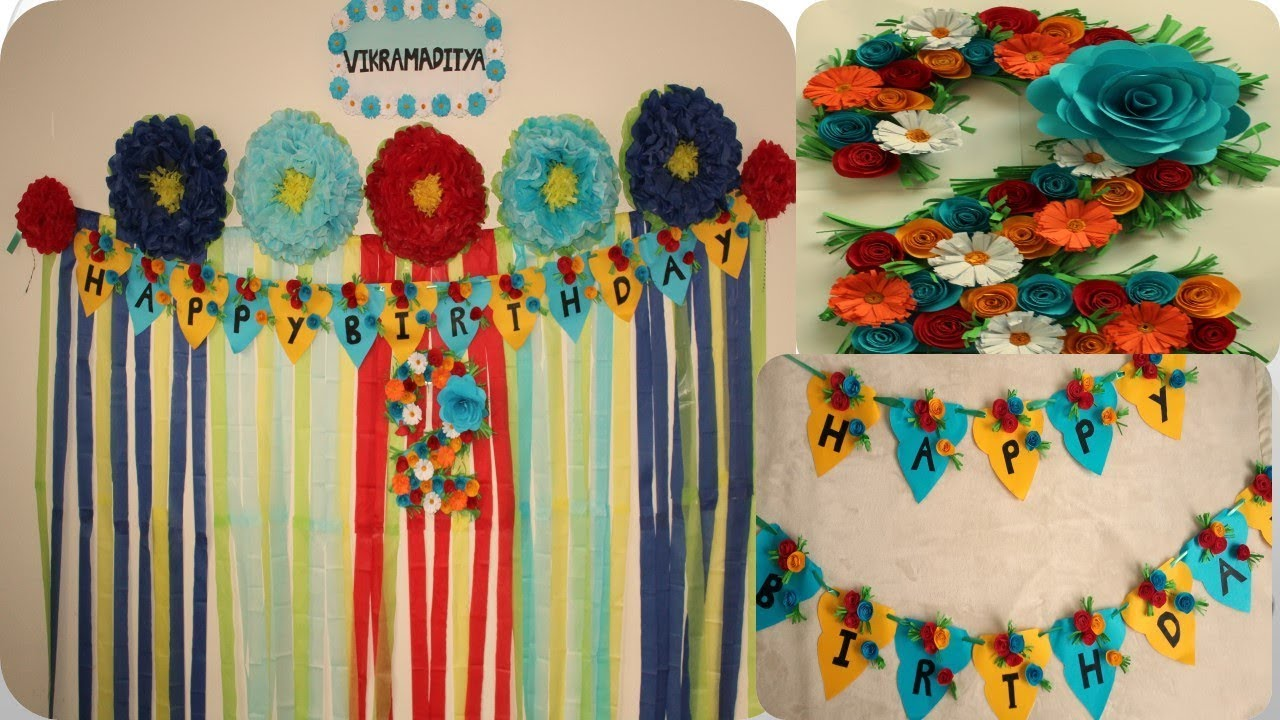Simple Second Birthday Decoration With Paper Backdrop Flowers Mom And Aditya