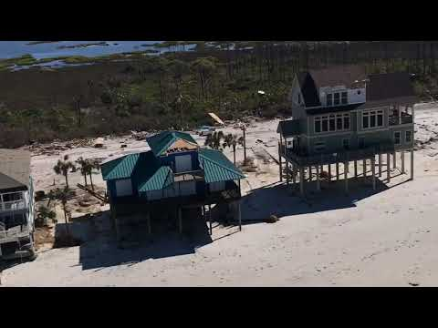 NEW chopper footage of Hurricane Michael damaging storm surge south of Mexico Beach, FL