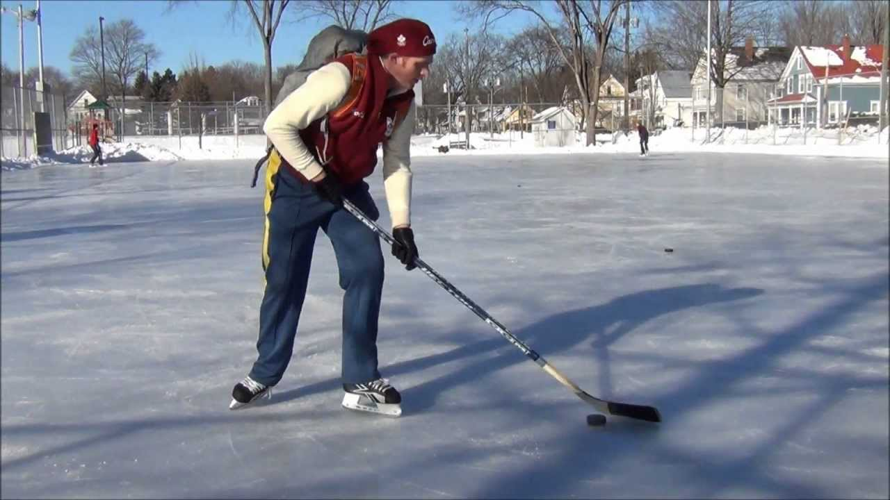 playing ice hockey at an outdoor rink in fredericton new