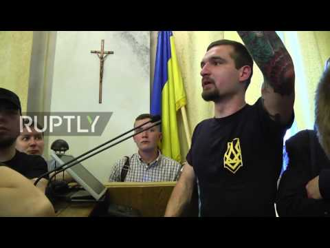 Ukraine: Svoboda members pepper-sprayed as far-right upends Lviv council session