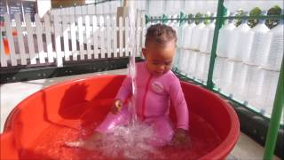 Babies enjoying water play at nursery