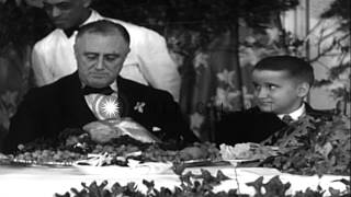 President Roosevelt and his wife, Eleanor, at a Thanksgiving dinner in the United...HD Stock Footage