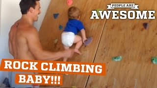 Fearless baby on the rock climbing wall!