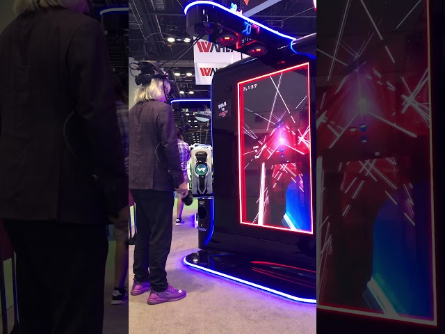 Bob playing Beat Saber by VRsenal at IAAPA 2019