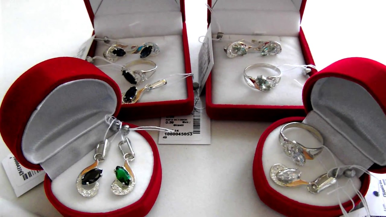 Серебряный набор с золотыми вставками и фианитом (серьги, кольцо и .