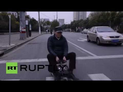 China: Man creates world's SMALLEST car to dodge crazy Shanghai traffic
