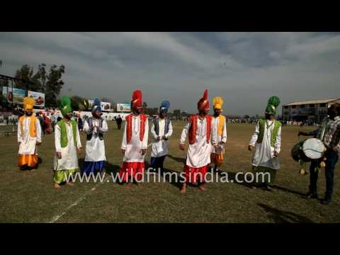 Sikh dancers perform Bhangra to dhol beats