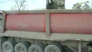 loading a dump trailer with an excavator