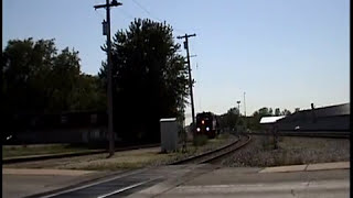 Rare CN/IC local on ex-C&O at Griffith, Indiana meets container train.
