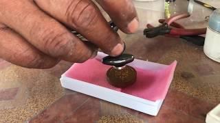 Using the Magnet Test on Plai Dam Powders Amulet Luang Phu Tim