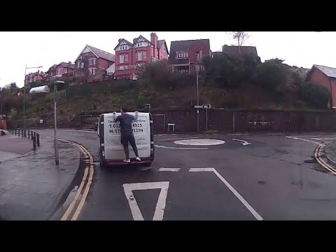 Crazy Builder Clings To Back Of Van Driving 30MPH