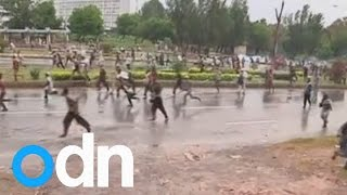 Protesters clash with Pakistan police, storm state TV