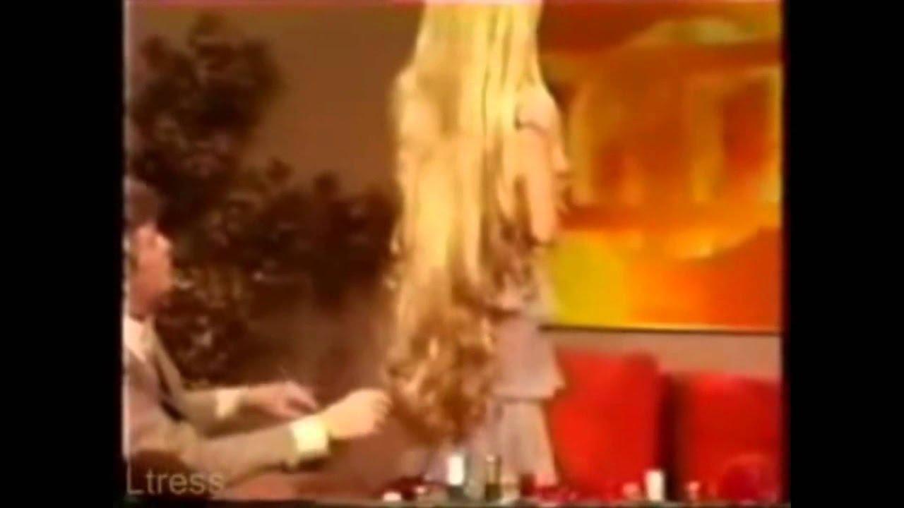 Debra Jo Fondren Standing Showing Off Her Extreme Length Of Long