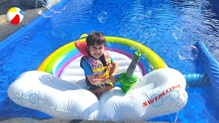 Zack and bubble machine toy in swimming pool - a fun activity