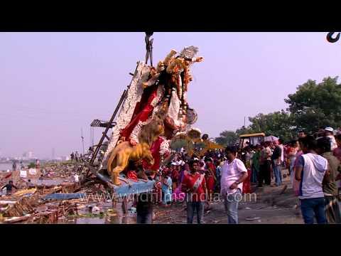 Visarjan with a motorized crane: mechanized Durga Puja in Delhi