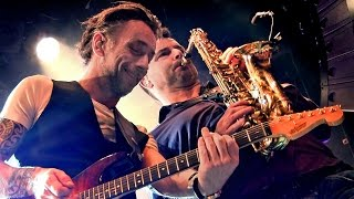 Powerful interaction between joost vergoossen on guitar and saxophone, when the symfo classics band performed 'tommy'. they delivered a high energy programme...