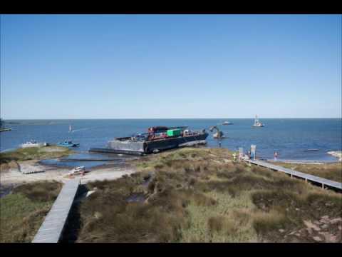 UPDATE: Runaway barges depart Avon, head back to Bonner Bridge