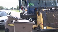 Trash company refusing to pay fines over automated pickup service