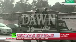 Taliban takes hundreds of students hostage in Pakistan school, scores killed