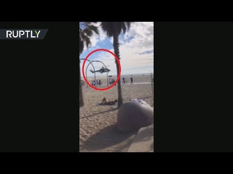 RAW: Helicopter lands by pier after California bomb scare
