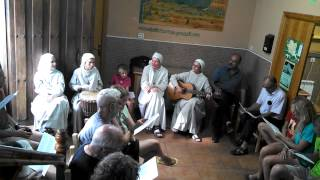 "41 pilgrims and guitar playing nuns sing ""Ultreia"""