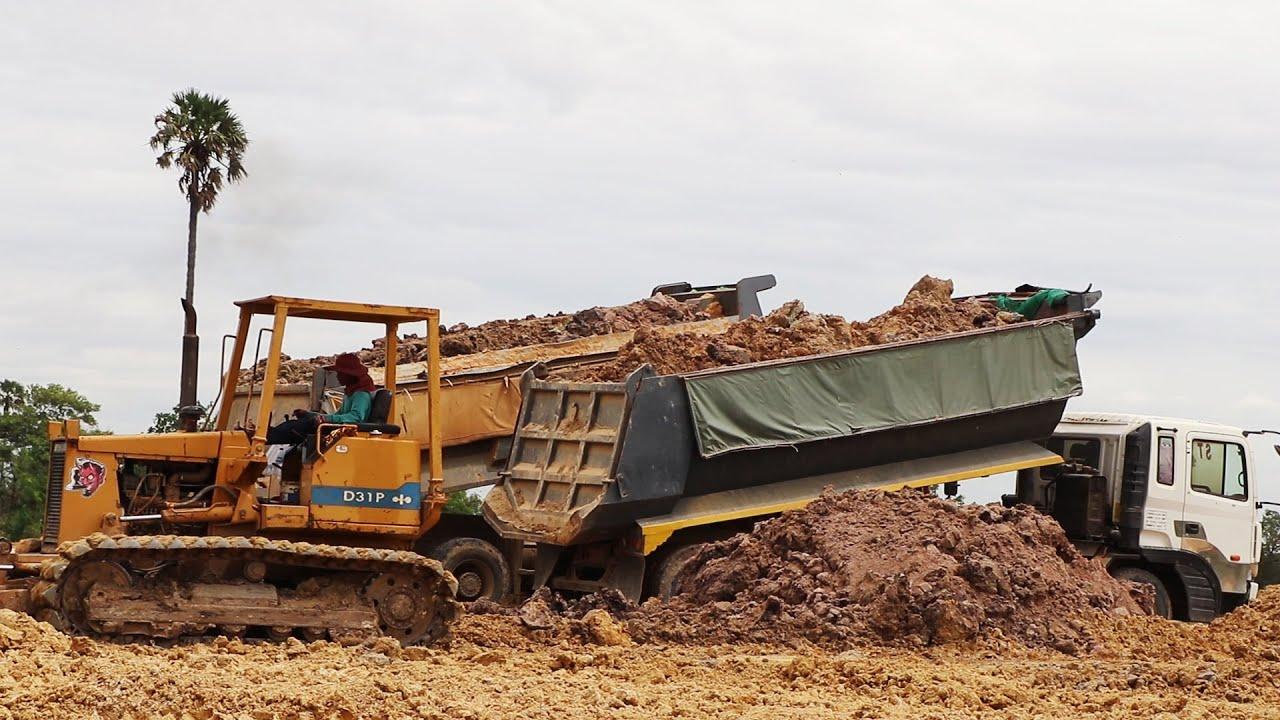 Big dump truck unloading soil