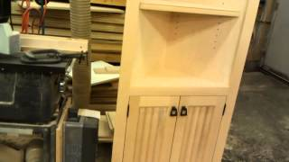 Here is a custom built a corner cabinet that I made that I will be finishing in a deep rich candy apple red stain with a black powder