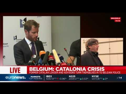 Deposed Catalan leader Carles Puigdemont turns himself in to Belgian police