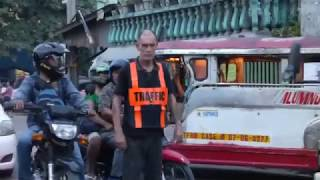 DANGEROUS JOBS. ENGLISH TRAFFIC ENFORCER DIRECTS TRAFFIC IN PHILIPPINES