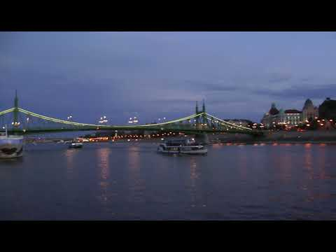 night view of sightseeing boats on the Danube in Budapest, Hungary