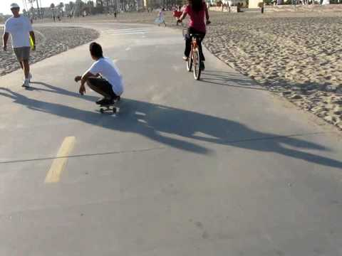 Learning how to longboard/skateboard at Santa Monica