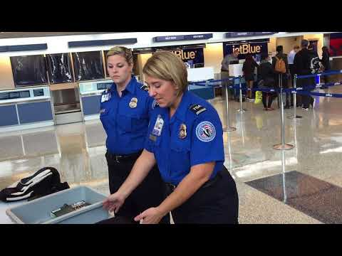 TSA personnel demonstrate updated carry-on screening rules