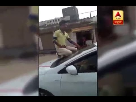 Allahabad: Viral Video: Youngster shows off pistol while sitting on car's bonnet