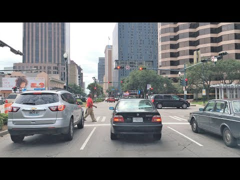 Driving Downtown 4K - New Orleans' Superdome Street - USA