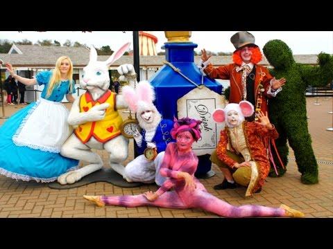 Alice in Wonderland tea party show. Alice in wonderland stilt walkers.