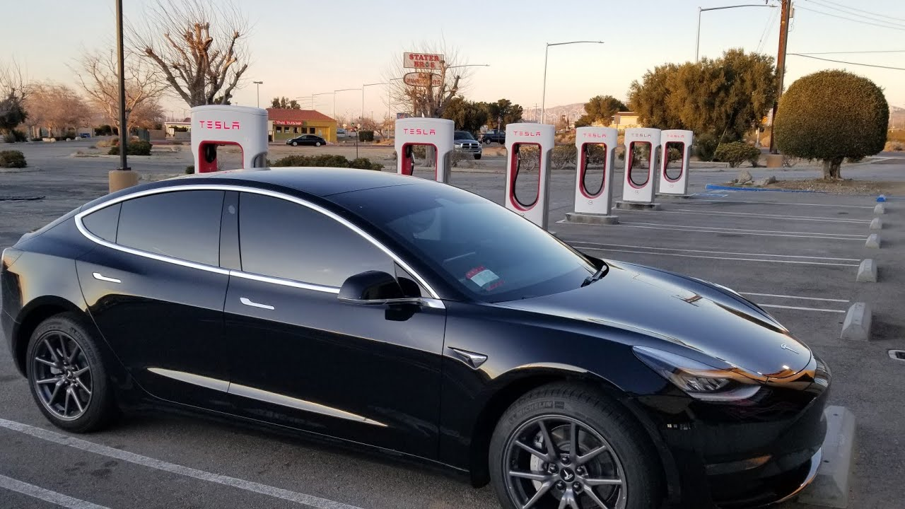 Tesla model 3 first road trip with super charging - YouTube