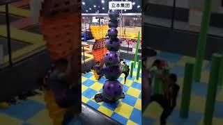 Ball Shape Climbing Wall With Auto Belay Inside A Trampoline Park