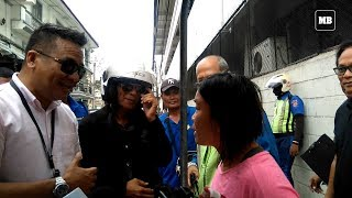 Woman tries to stop MMDA from towing her motorized food stall in Intramuros