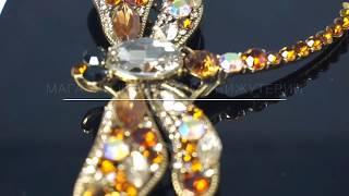 Брошь с кристаллами желтая