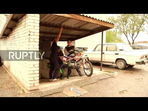 Russia: Mechanics create a device to allow motorbike to travel over any surface