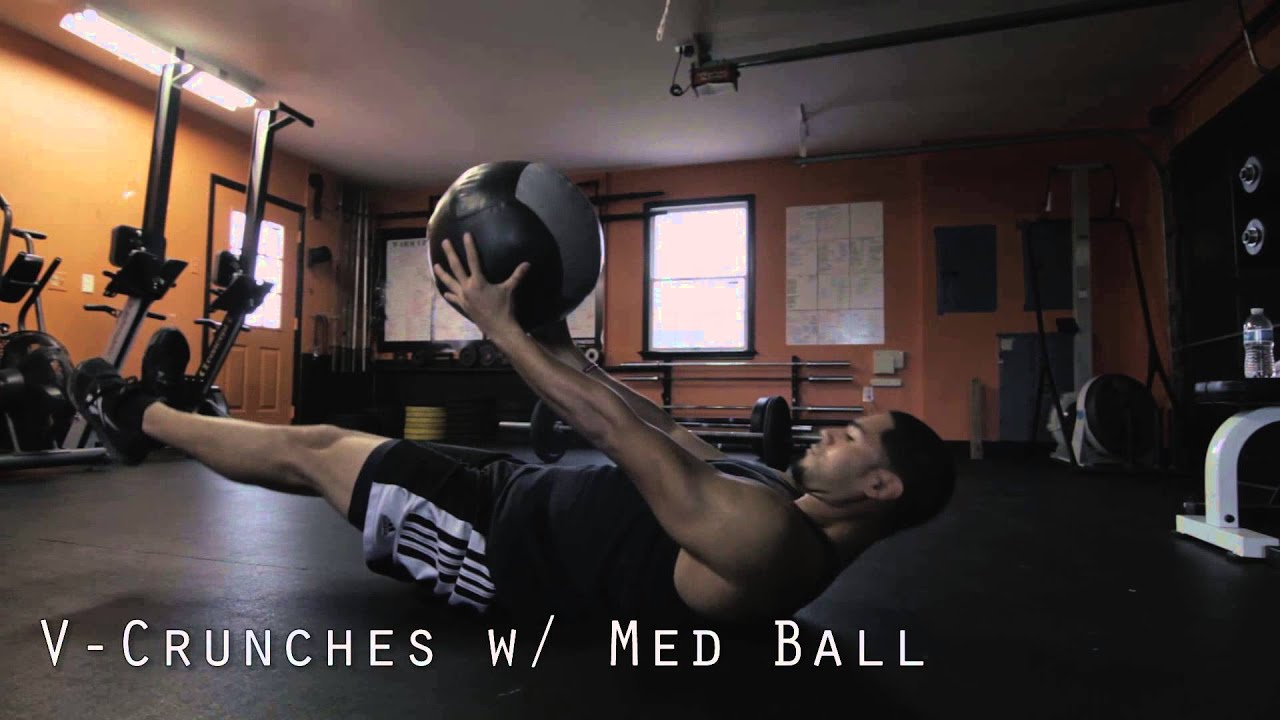 Hanging knee raises with medicine ball - V Crunches With Med Ball How To Perform Ab Workouts Exercises