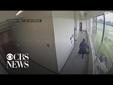 Surveillance video captures dramatic moment football coach disarmed student with gun