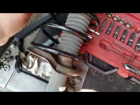 Peugeot 307 coil spring and anti-roll bar link replacement.